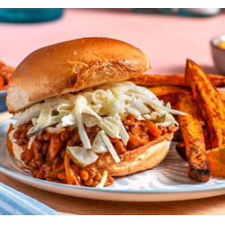 Smoky Lentil Sloppy Joes with sweet potato fries and dill pickle slaw